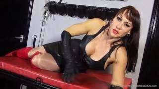 Mistress Miranda in leather corset, gloves and red leather over the knee boots