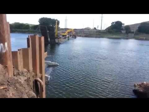 Sinking of pipe across cedar river