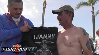 Manny Pacquiao signs Mexican ice cream man's shirt who is a Pacquiao fan
