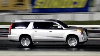 2015 Escalade vs 2015 Mustang GT - 1/4 Mile Drag Race - Road Test TV ®