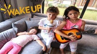 Masal play musical instruments and wake up Sisters
