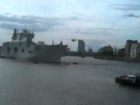 Helicopter landing on naval ship at greenwich dock