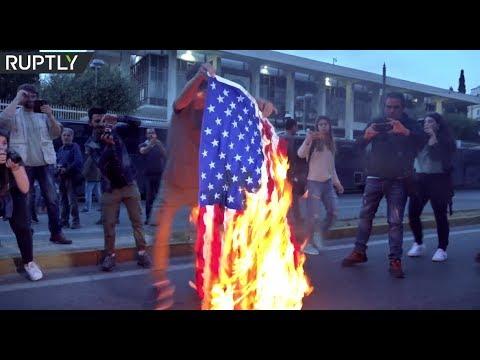 Athenians burn US flag outside American embassy as hundreds decry Syria strikes
