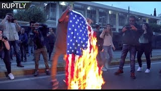 Athenians burn US flag outside American embassy as hundreds decry Syria strikes