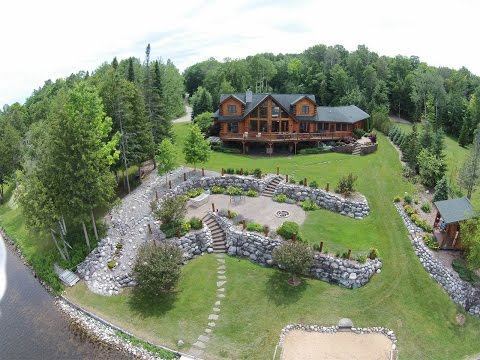 Inviting Waterfront Log Home in Indian River, Michigan