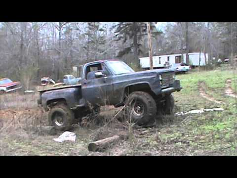 my son playing in the mud with his chevy 4x4