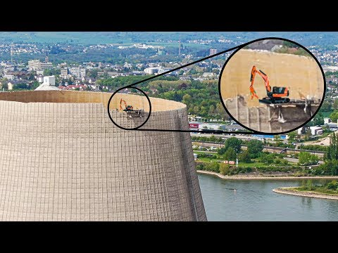 Excavator on 600 feet Cooling Tower (remote-controlled)