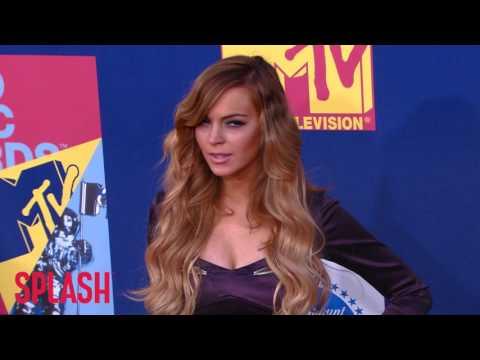 Lindsay Lohan Just 'Educating Herself' on Nation of Islam | Splash News TV