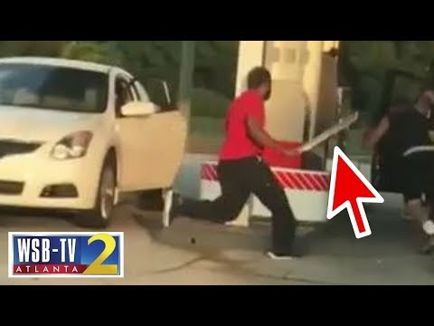 Wild: Machete-swinging driver stalks victim at gas station! from YouTube · Duration:  2 minutes 25 seconds