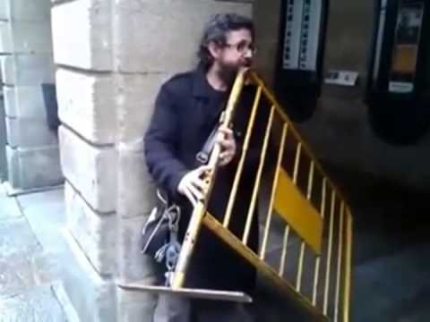 Guy Plays Metal Barrier Like A Flute