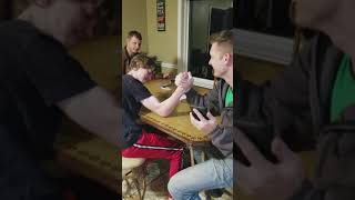 15 teen year-old arm wrestling with his 34 old dad.