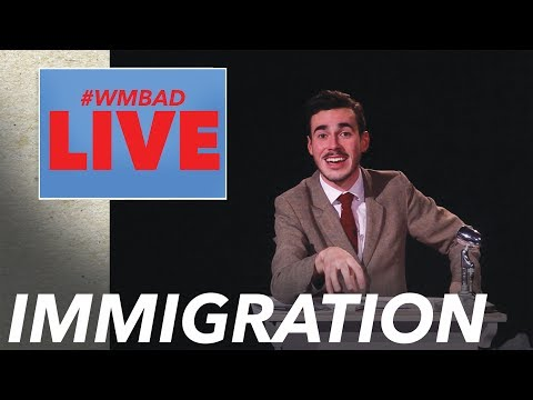 Immigration | White Man Behind A Desk