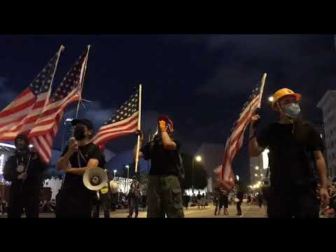 Hong Kong protesters sing American National Anthem w/ U S  flags