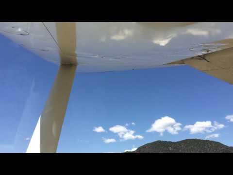 Cessna 180 landing at La Garita Creek Ranch