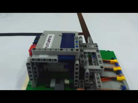 Safe deposit box with a key to unlock made by lego parts.