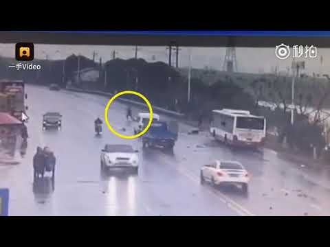 Crane driver rescues passengers after bus crashes into river in Changzhou, China