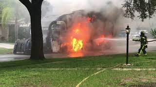 Tampa Firefighters fight a garbage truck fire in Old Carrollwood