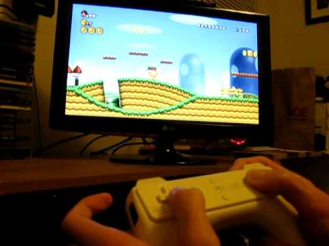 Playing New Super Mario Bros. Wii Using My Modded Wiimote With A Bigger D-pad And Buttons.