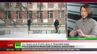 Teen gunman kills teacher, takes classmates hostage