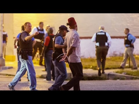 Cities around Ferguson accused of 'terrorizing' poor and minorities