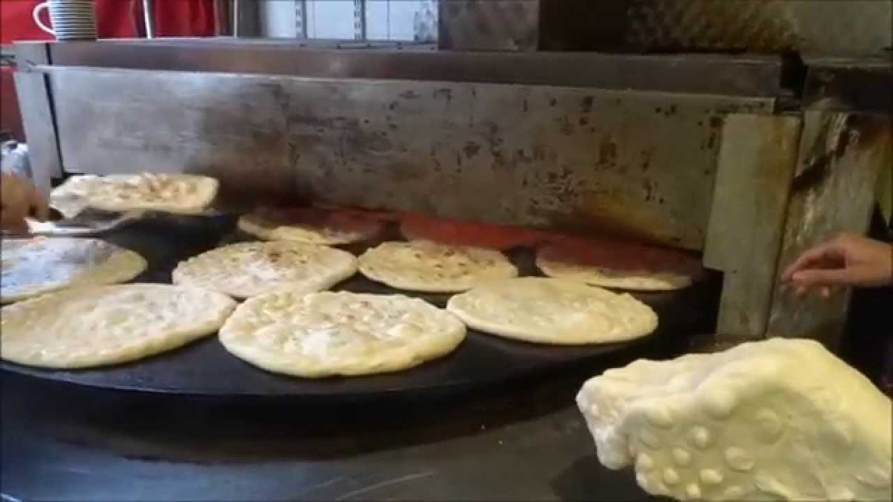 indian street food  fresh garlic  u0026 cheese naan wrap