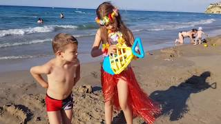 Kids playing on the beach. Video from KIDS TOYS CHANNEL