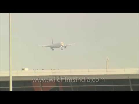 Delhi airport with flights landing on main runway