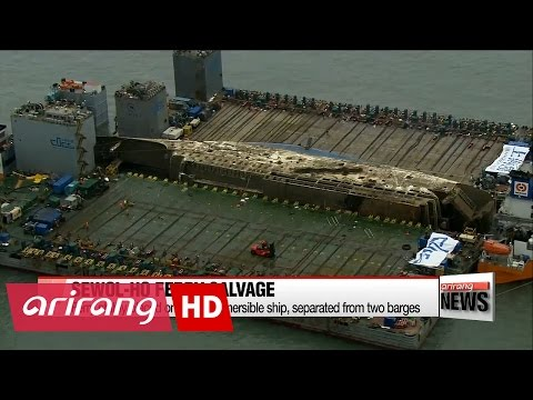 Sewol-ho ferry placed on semi-submersible ship, separated from two barges