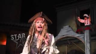 Johnny Depp surprises fans on the Pirates of the Caribbean ride as Captain Jack Sparrow.