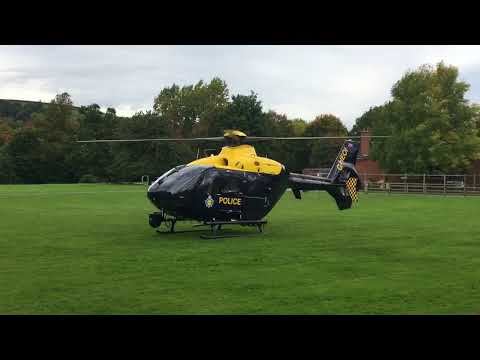 Dyfed Powys Police (NPAS) helicopter taking off.