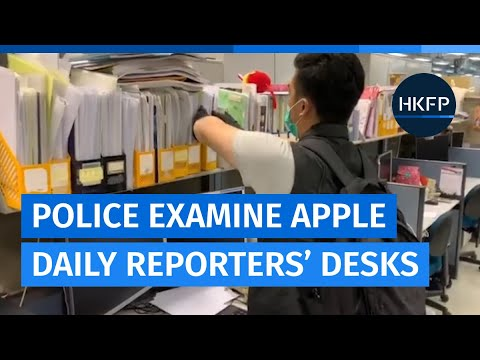 Police examine Apple Daily staffers' desks despite assurances from top cop