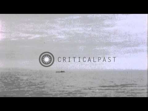 USS Tirante (SS-420) sinks Japanese Junk in waters off Japan during World War II HD Stock Footage