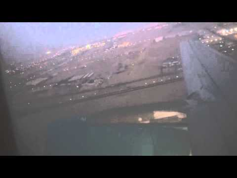 Airbus a320-200 sunset takeoff in Kuwait international airport Jazeera airways