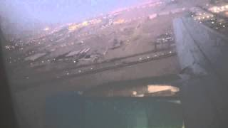 Airbus a320-200 sunset takeoff in Kuwait international airport Jazeera airways
