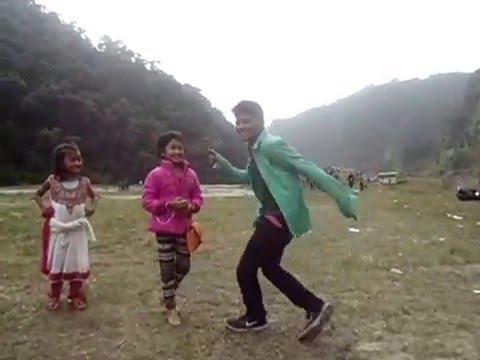 A boy dancing on Nepali song Dhoka kholana Puste ki aama by Rabindra Chhetri