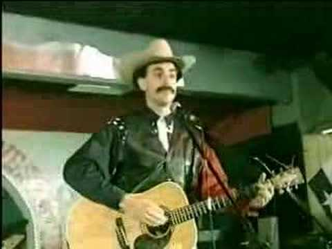 "One of the greatest trolls of all time. Sacha Baron Cohen as Borat in the cowboy singalong; ""Throw the Jew down the well."""
