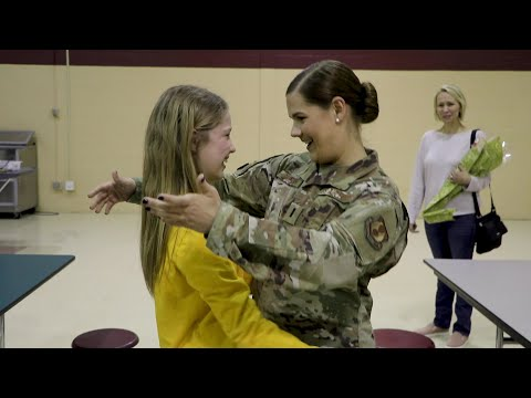 Sisters reunite at McGuire Middle School after deployment
