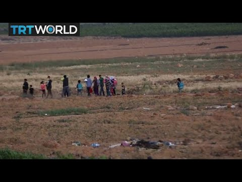 Refugee Crisis: Displaced Syrian children use tent as classroom