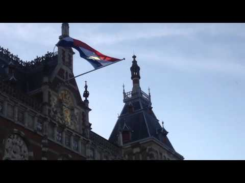 Dutch flag waiving on Central Station Amsterdam