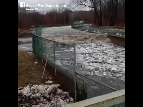 Avoca, PA - Water rushes back upstream after ice jam broken up