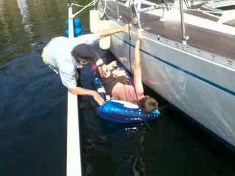 Erik cleaning the boat's toilet tank