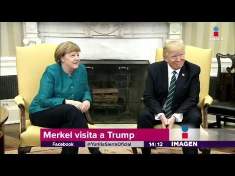 Invita a Merkel... ¡y no le da la mano!