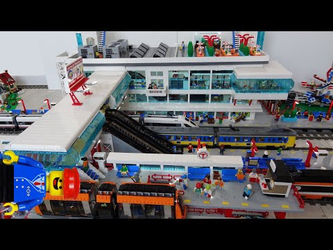 Thumbnail: Huge Lego train station MOC of 25000 bricks with Lego monorail and bus platforms