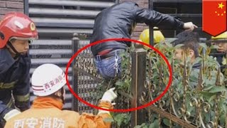 Chinese man's buttocks impaled by two metal spikes after falling from 2nd floor   TomoNews