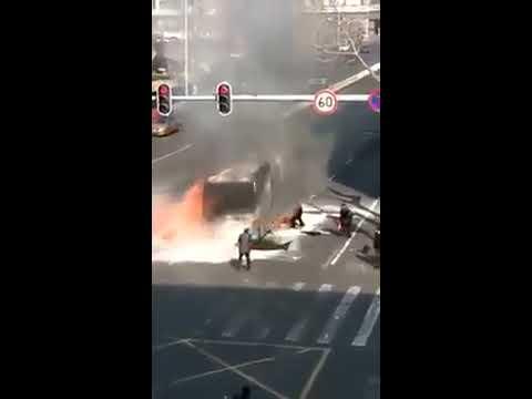 Terrifying moment passengers flee burning bus