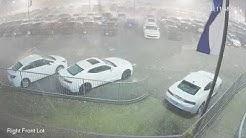 Surveillance video of baseball-sized hail damaging new vehicles in Cullman, Alabama
