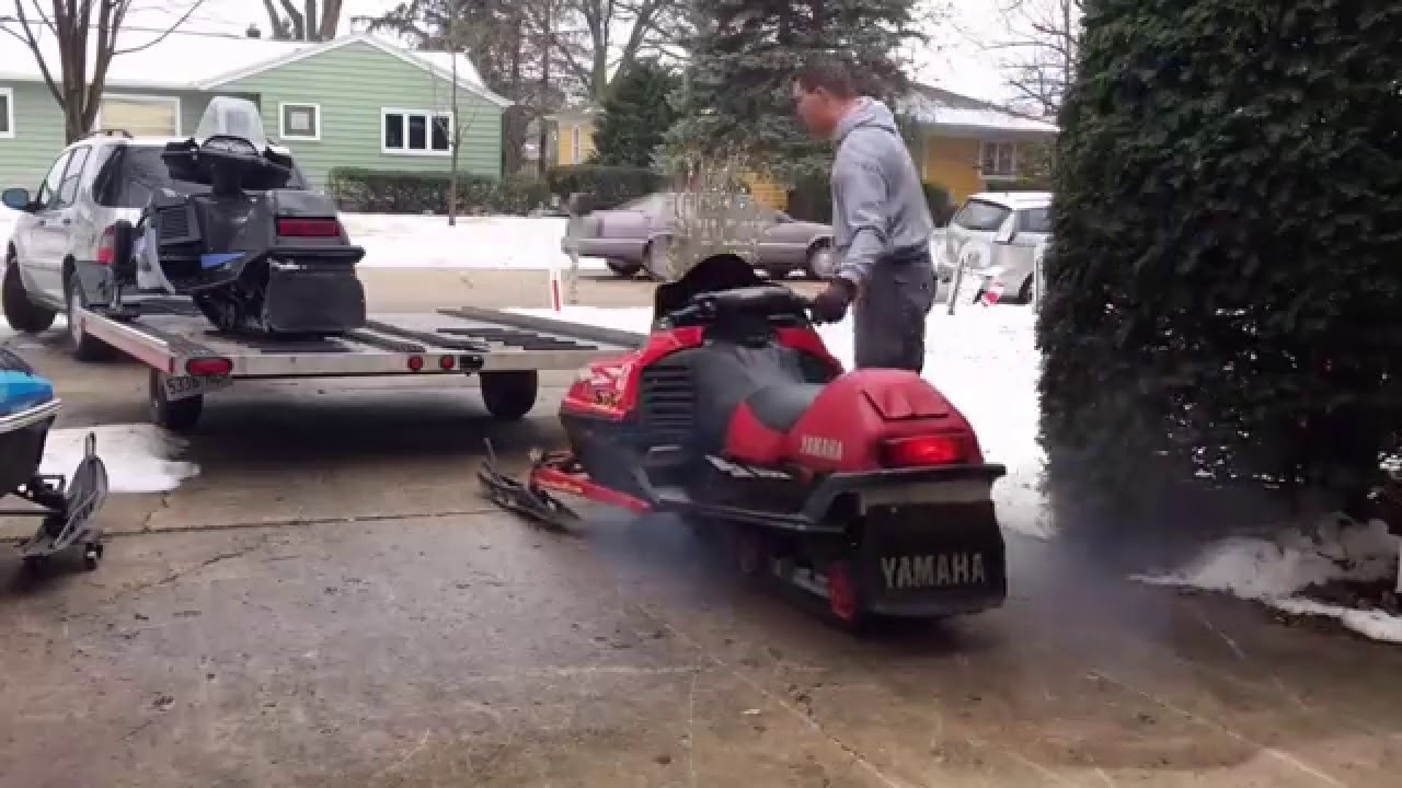 Loading 2 Yamaha Snowmobiles And 1 Arctic Cat On A 2 Place