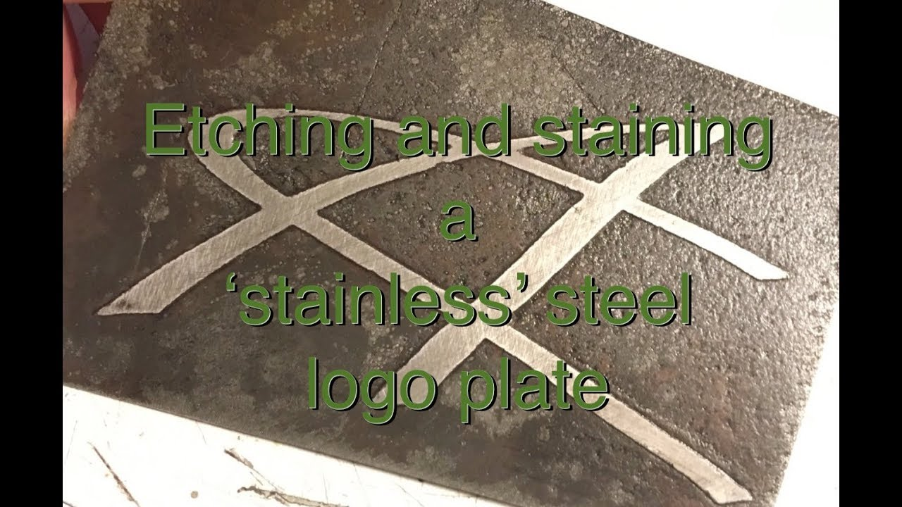Etched and oxidized stainless steel logo plate: art meets science