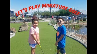 Family Day Playing MInature Golf