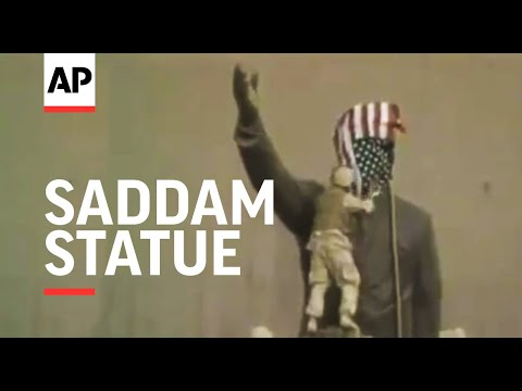 Saddam Hussein statue and pictures destroyed 2003